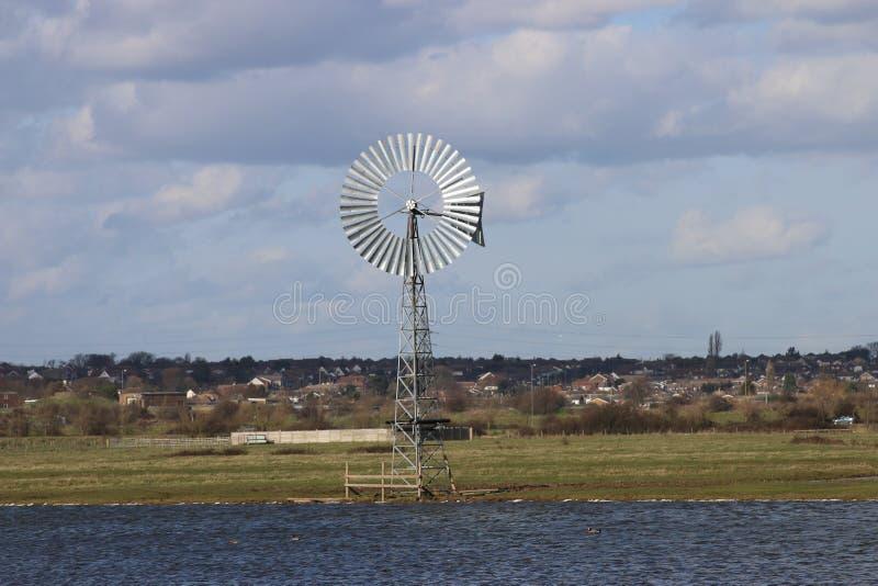 Windmill green power production stock photos