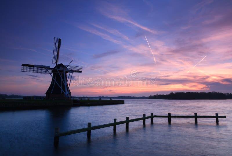 Windmill @ lake stock photo