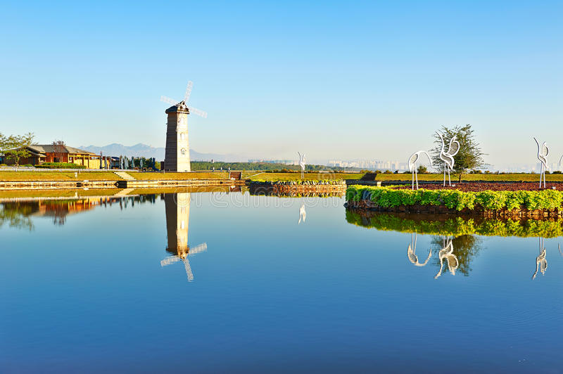 The windmill lakeside. This photo was taken in beidaihe district qinhuangdao city, hebei province,china.The time was October 2, 2013 stock photography