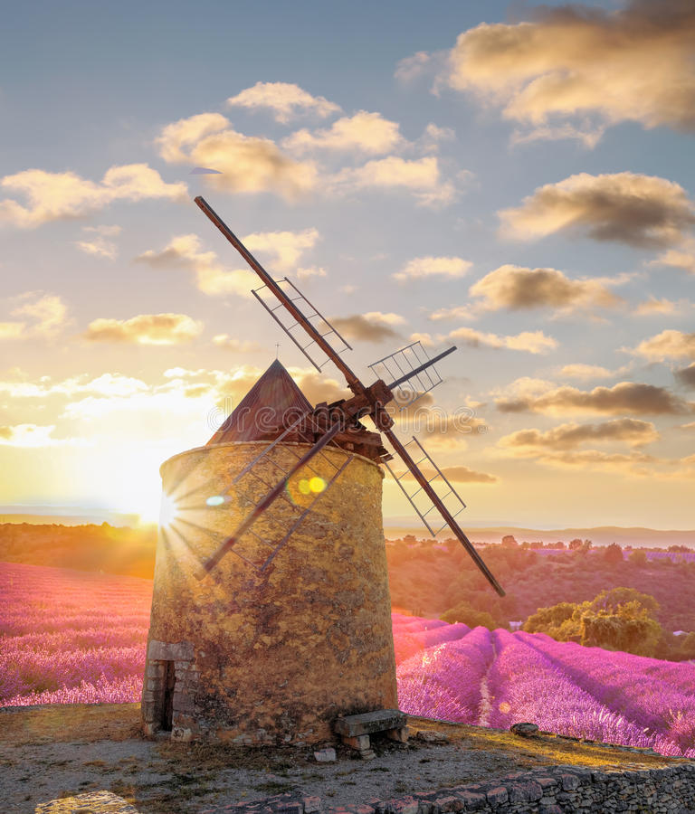 Windmill with levander field against colorful sunset in Provence, France. Windmill with levander field against colorful sunset in famous Provence, France royalty free stock image