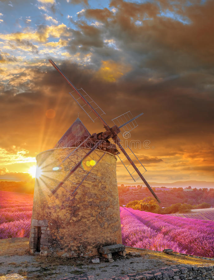 Windmill with levander field against colorful sunset in Provence, France. Windmill with levander field against colorful sunset in famous Provence, France stock photography