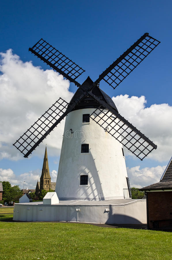 Windmill at Lytham-St-Annes, Lancashire. Whitewashed windmill with black sails, tourist attraction and museum, at Lytham-St-Annes, Lancashire, England stock photography