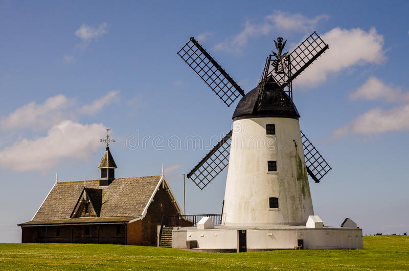 Windmill at Lytham-st-Annes. Windmill with whitewashed walls and black sails , a museum and tourist attraction, at Lytham-St-Annes in Lancashire, England royalty free stock images