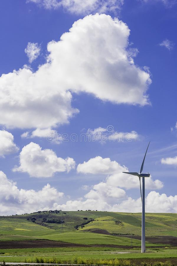 Windmill on meadow royalty free stock image