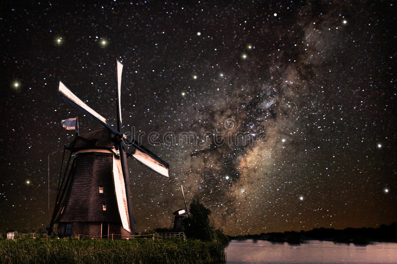 A Windmill and the milky way royalty free stock image