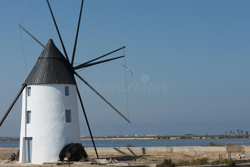 Windmill Molino Calcetera San Pedro del Pinatar, Murcia, Spain. Molino Calcetera - Historic windmill in the salt marshes at San pedro del Pinatar. Situated in royalty free stock photos