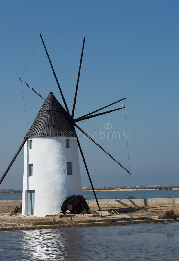 Windmill Molino Calcetera San Pedro del Pinatar, Murcia, Spain. Molino Calcetera - Historic windmill in the salt marshes at San pedro del Pinatar. Situated in stock photos