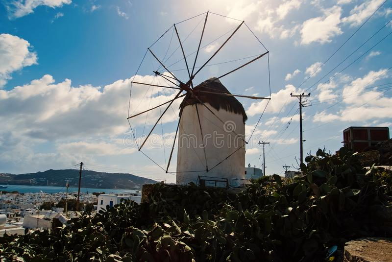 Windmill in Mykonos, Greece. Windmill on mountain landscape by sea. Whitewashed building with sail and straw roof with. Nice architecture. Vacation on royalty free stock photo