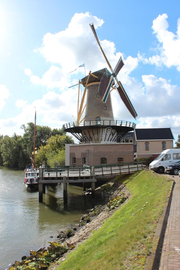 Windmill named Windlust in Nieuwerkerk aan den IJssel with blue sky and white clouds stock photo