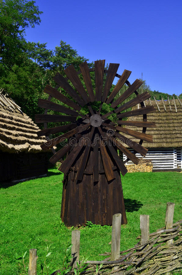 Windmill. Old wooden windmill grain mill royalty free stock images