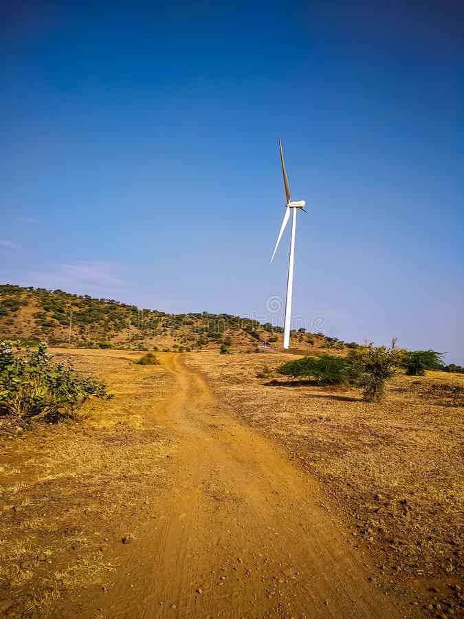windmill over the landscape with dark blue sky background in india. royalty free stock images