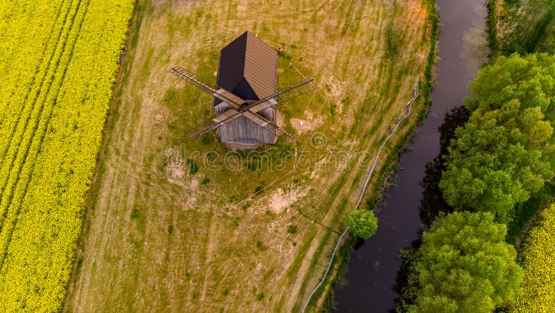 Windmill in polish country. Windmill polish country polishcountry nature landscape agriculture trees architecture river fields aerialview nopeople stock photos