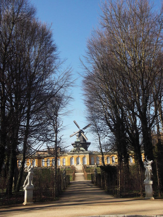 A view of the windmill in Sanssouci Park, Potsdam, Germany. A view of the palace in Sanssouci Park, Potsdam, Germany. Potsdam is within the former GDR (East royalty free stock photo