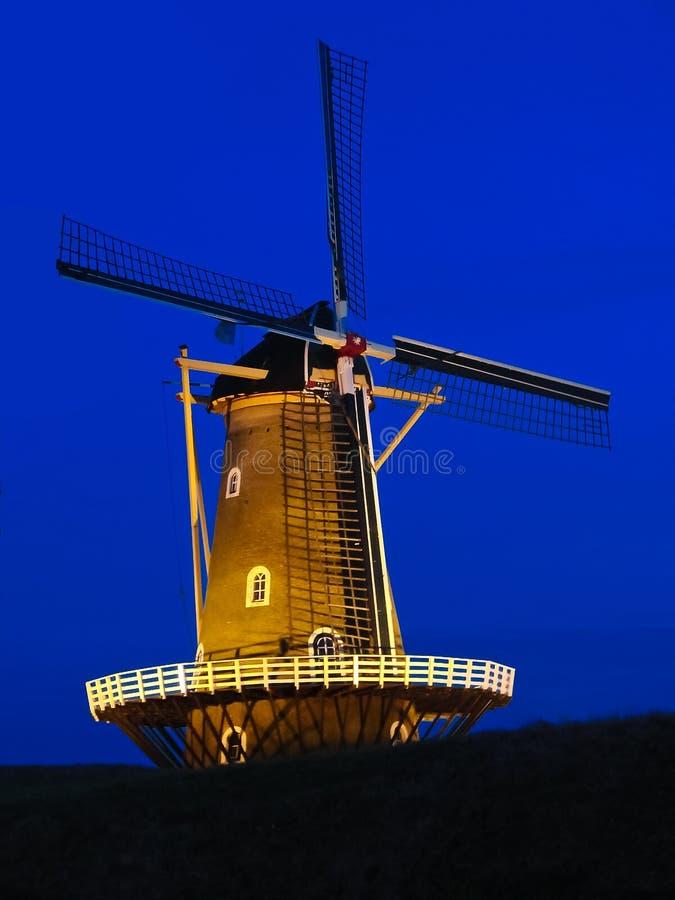 Windmill quiet at night. stock photos