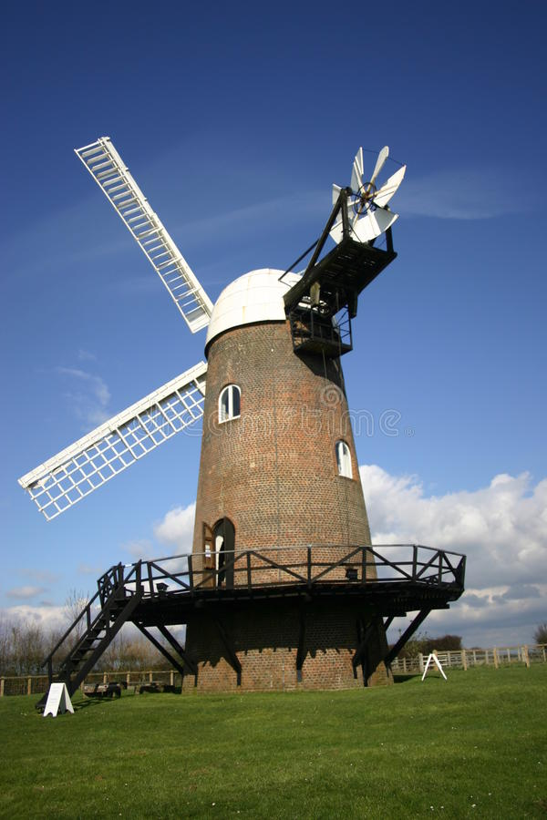 Windmill. From the rear showing the cap and two sails with a background of blue sky with white clouds stock photos