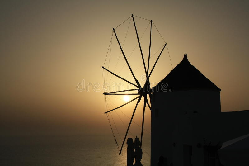 Windmill romantic sunset summer sea royalty free stock images