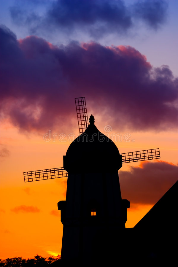Windmill Silhouette At Sunset. ~ Orange, Blue, Yellow And Purple Sunset royalty free stock images
