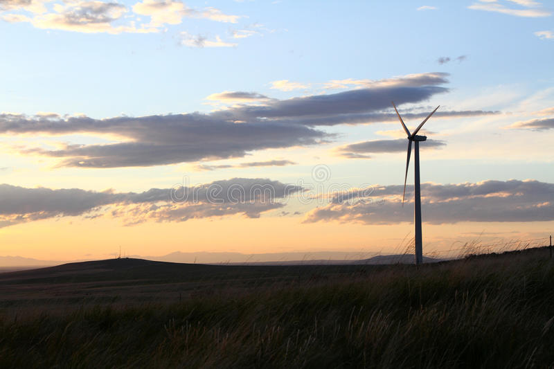 Download A Windmill Sillouetted By A Sunset Royalty Free Stock Photos - Image: 25366038
