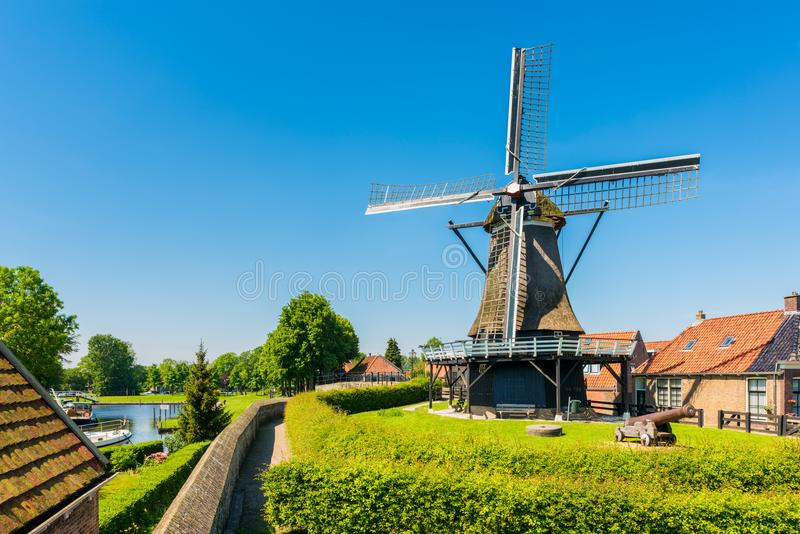 Windmill in Sloten Netherlands royalty free stock photography