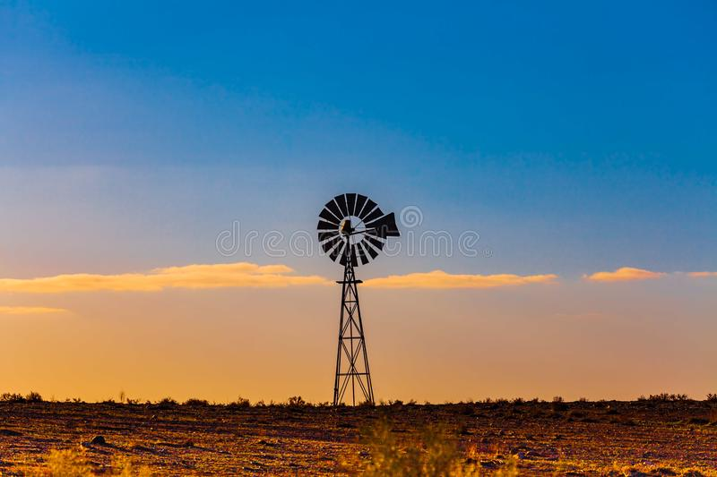 Windmill in South Australia at sunset. royalty free stock photos