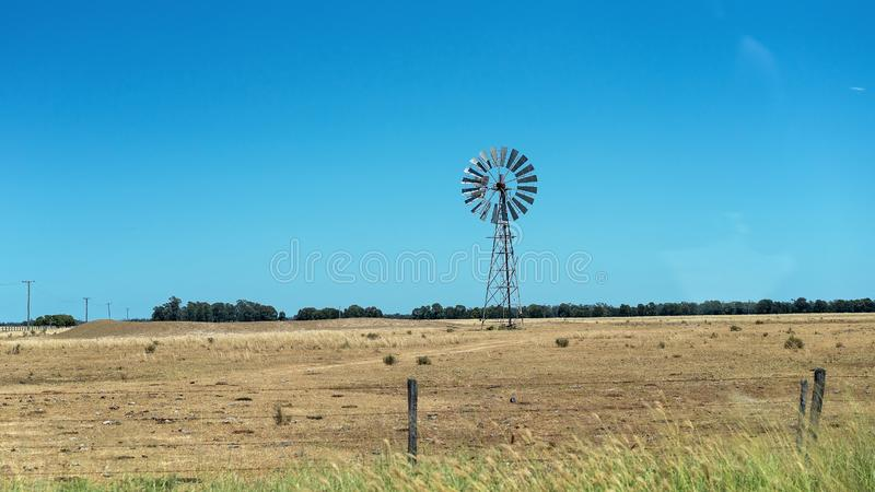 Windmill In Vast Open Outback Space royalty free stock images