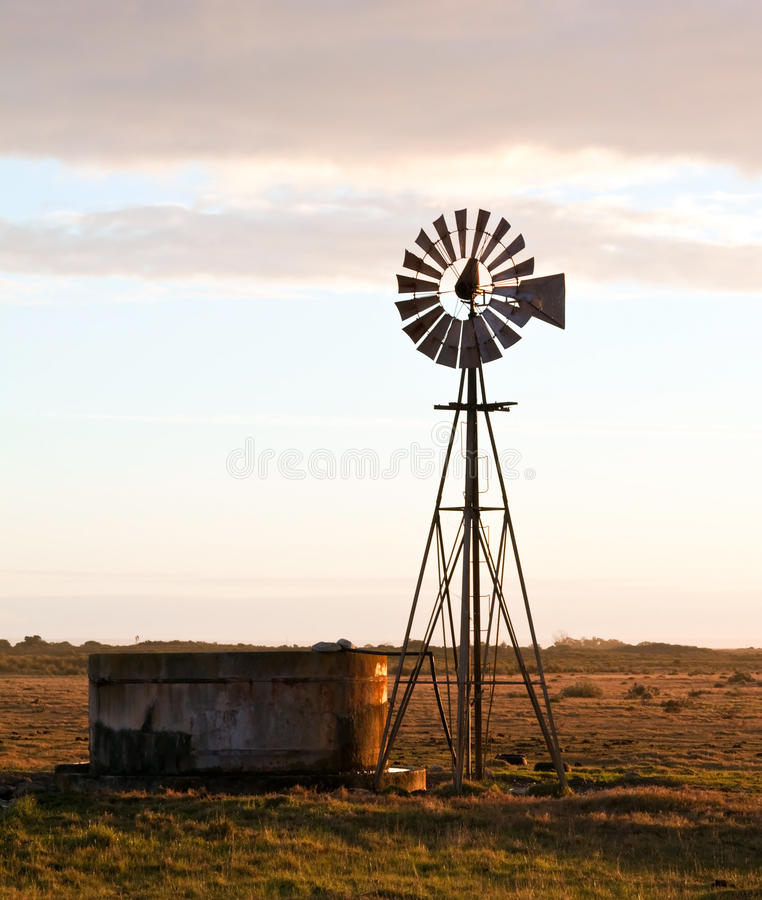 Windmill at sunrise stock image