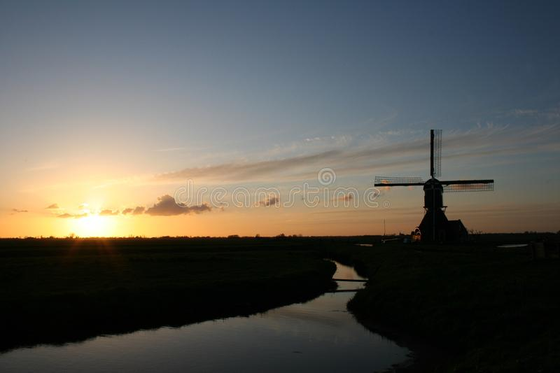 The windmill at sunrise. This beautiful windmill in the Netherlands by sunrise stock photos