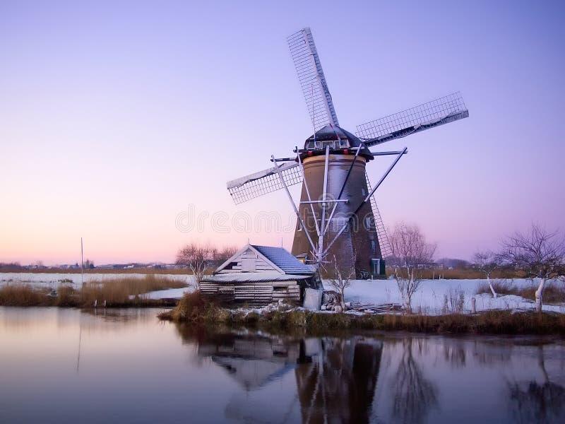 Windmill sunrise in Holland stock photo