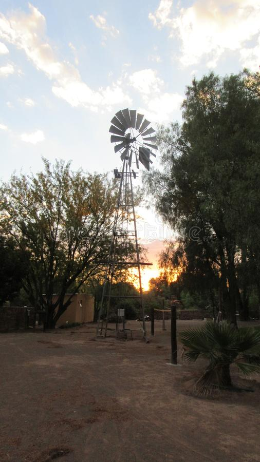 Windmill sunset. Sunset in the Karoo SouthAfrica stock image