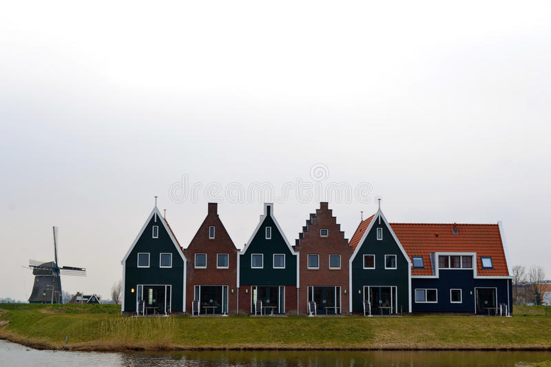 Windmill and typical houses Netherlands royalty free stock photography