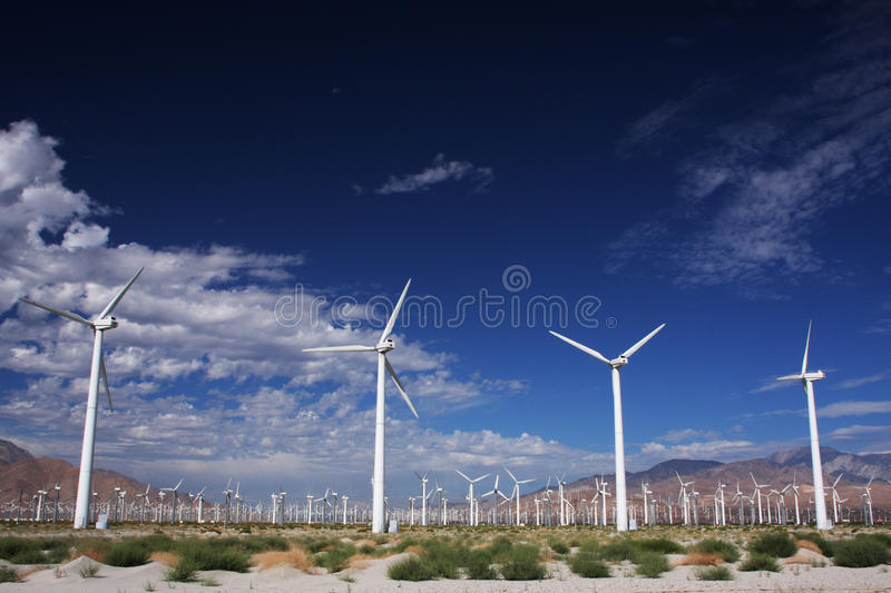 Windmill valley. A valley between mountain ridges stuffed with windmills producing electricity royalty free stock image