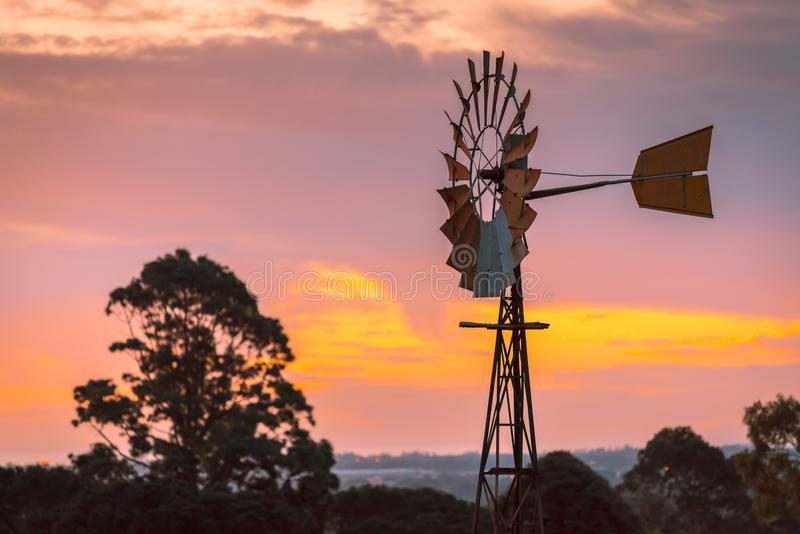 Windmill at sunset in rural South Australia stock images
