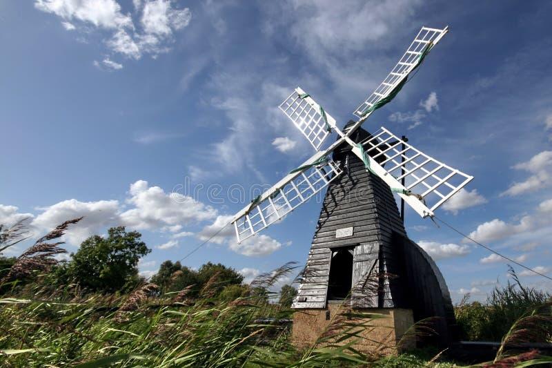 Windmill at Wicken Fen. The oldest working wooden windpump at Wicken Fen in Cambridgeshire royalty free stock photography