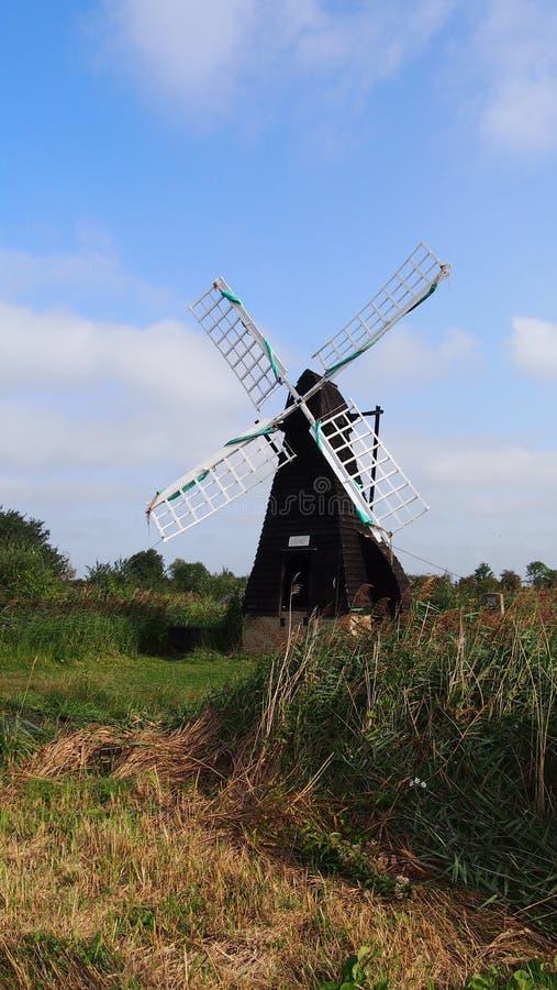 Windmill at Wicken Fen, England. The oldest working wooden windpump at Wicken Fen in Cambridgeshire, Great Britain stock photos