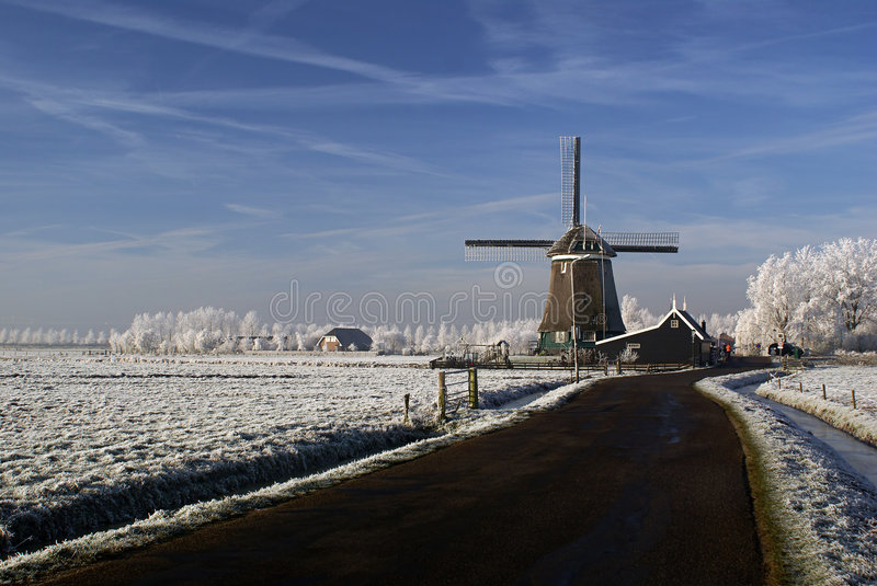 Windmill in a winter landscape royalty free stock photos
