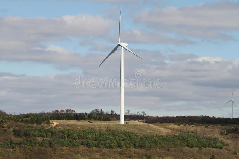 Windmills. On a hillside during a sunny day stock image