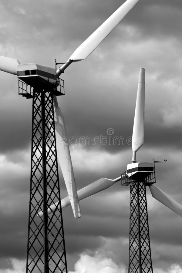 Windmills - Alternative energy source. Environmentally friendly power plant against cloudy sky royalty free stock photo
