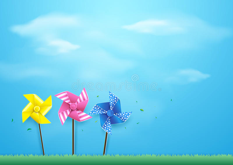 Windmills blowing in the wind on blue sky. Paper art style royalty free illustration