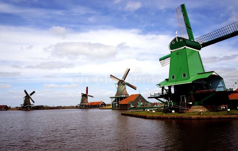 Windmills. Buildings and windmills in Zaanse Schans ethnographic museum in Netherlands stock photos