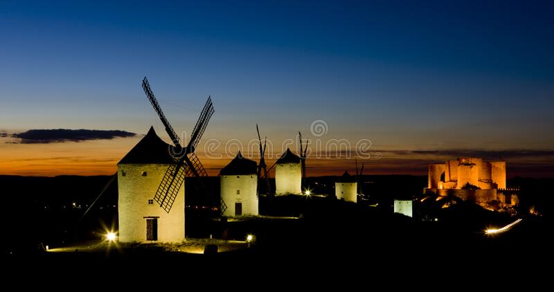 Windmills with castle at night, Consuegra, Castile-La Mancha, Sp. Ain royalty free stock photography