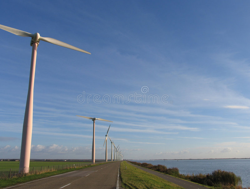 Windmills in Dutch landscape stock photo