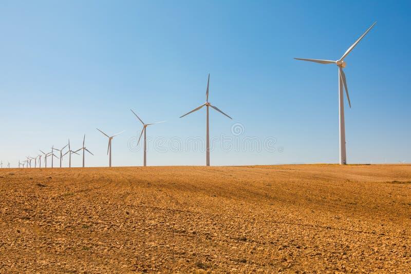 Windmills for electric power production, Zaragoza province, Aragon, Spain. stock photos