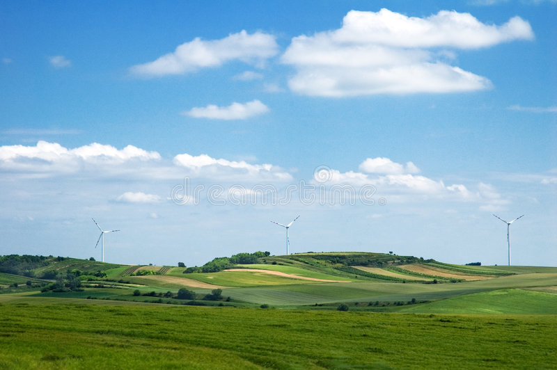Download Windmills Between Farm Field Stock Photo - Image: 1223350