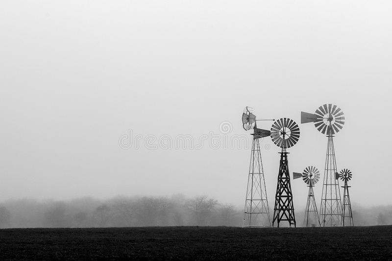 Windmills in the fog royalty free stock image