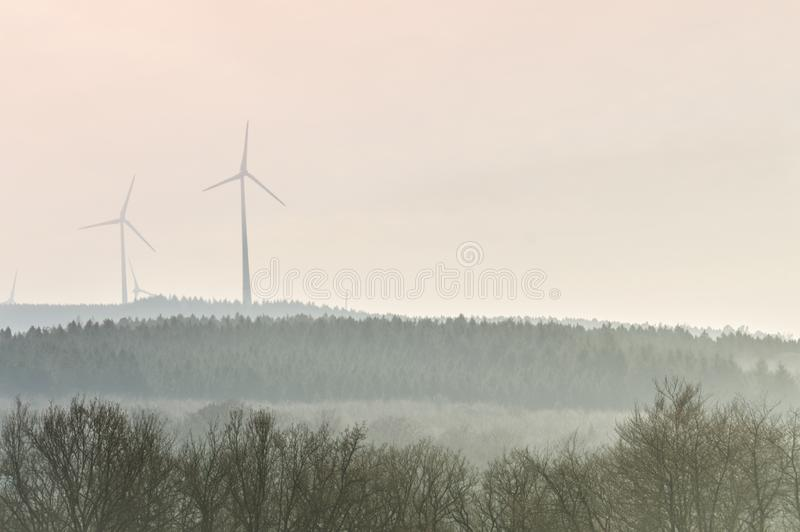 Windmills harvesting wind power stock photos