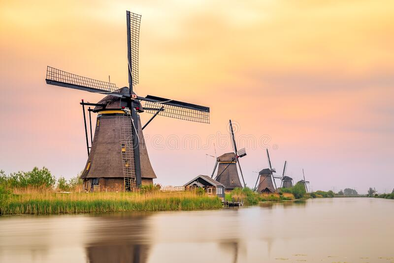 Windmills in Kinderdijk at sunset, The Netherlands royalty free stock image