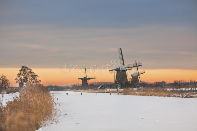Download Windmills In Kinderdijk At Winter Sunset Stock Photo - Image: 18480774