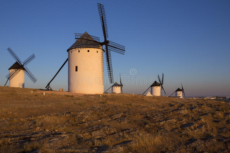 Windmills of La Mancha - Spain. Late afternoon sunlight on the windmill in Campo de Criptana in the La Mancha region of central Spain stock image