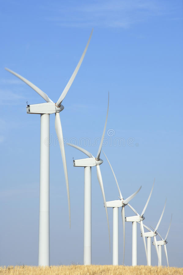 Windmills lined stock photos