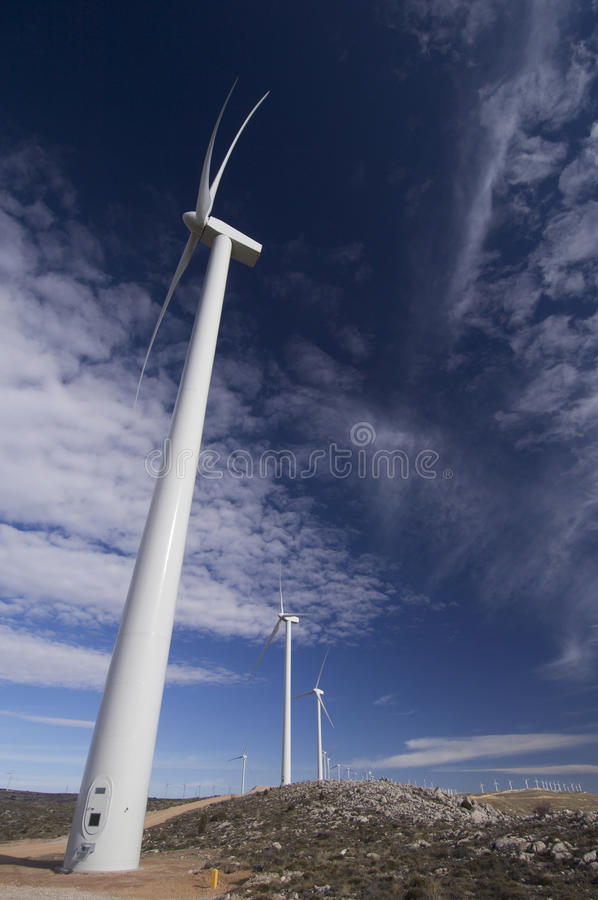 Download Windmills lined stock photo. Image of field, countryside - 12530496